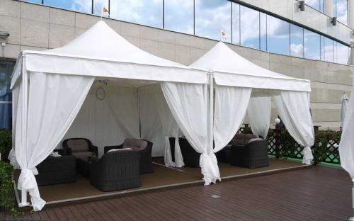 Защитные шторы для летних веранд. Защитно-декоративные шторы. Москва, Отель Лотте Рус